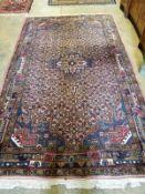 A North West Persian peach ground carpet, 260 x 156cm