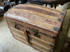 A late Victorian domed top travelling trunk, length 86cm, depth 52cm, height 64cm