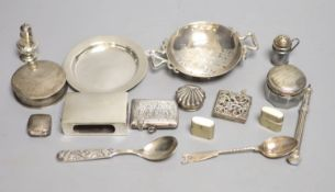 Small silver including a tea strainer, nut dish, match sleeve, two peppers, pill box, two teaspoons,