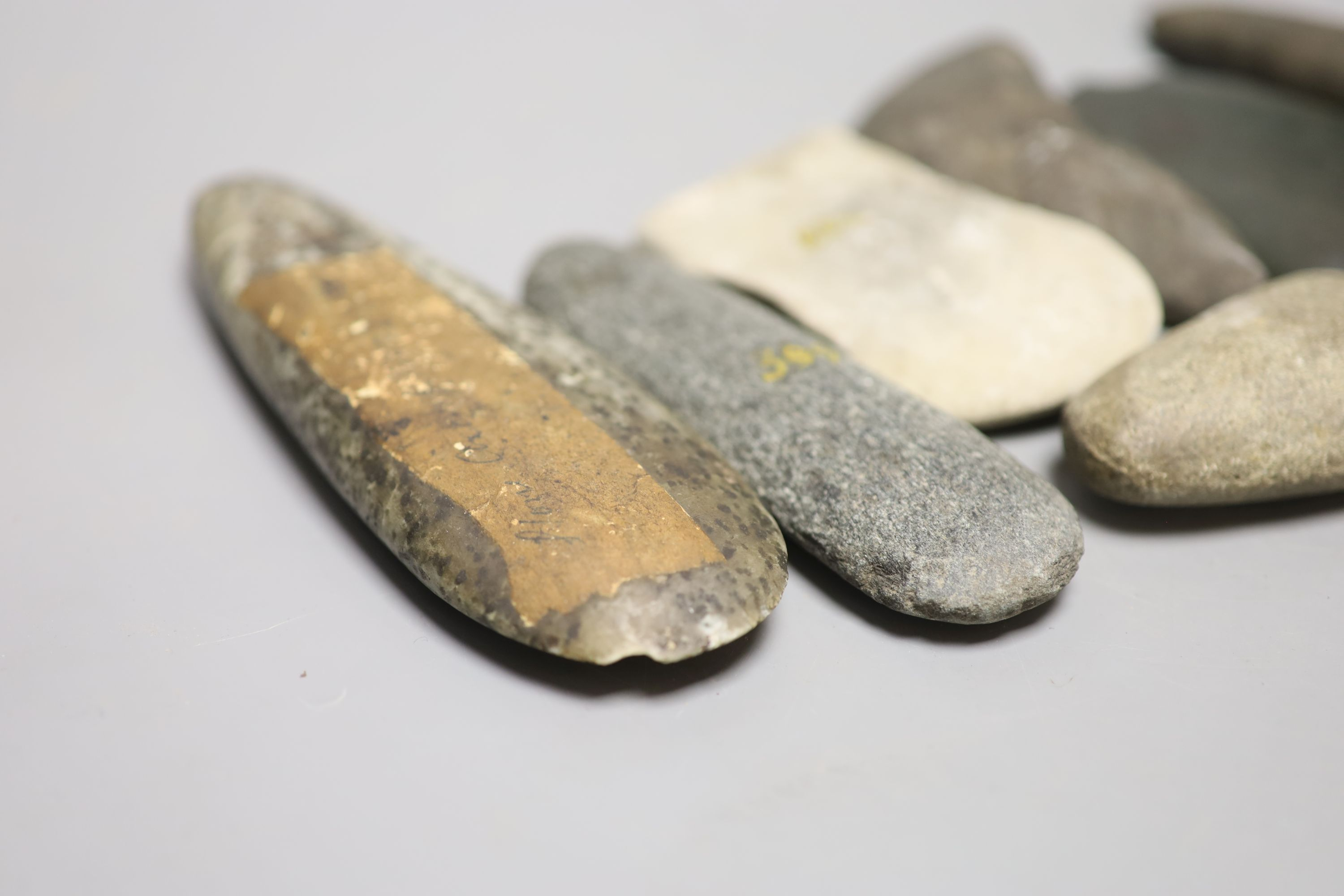A group of stone adze hand tools, three 19th century Papua New Guinea, each labelled New Guinea, - Image 3 of 6