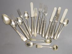 A set of six silver handled dessert forks, four silver handled dessert knives, a Georgian silver