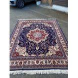 A Duruder blue ground carpet, 306 x 242cm