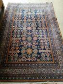 A Caucasian blue ground rug, 200 x 132cm