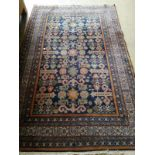 A Caucasian blue ground rug, 200 x 132cm