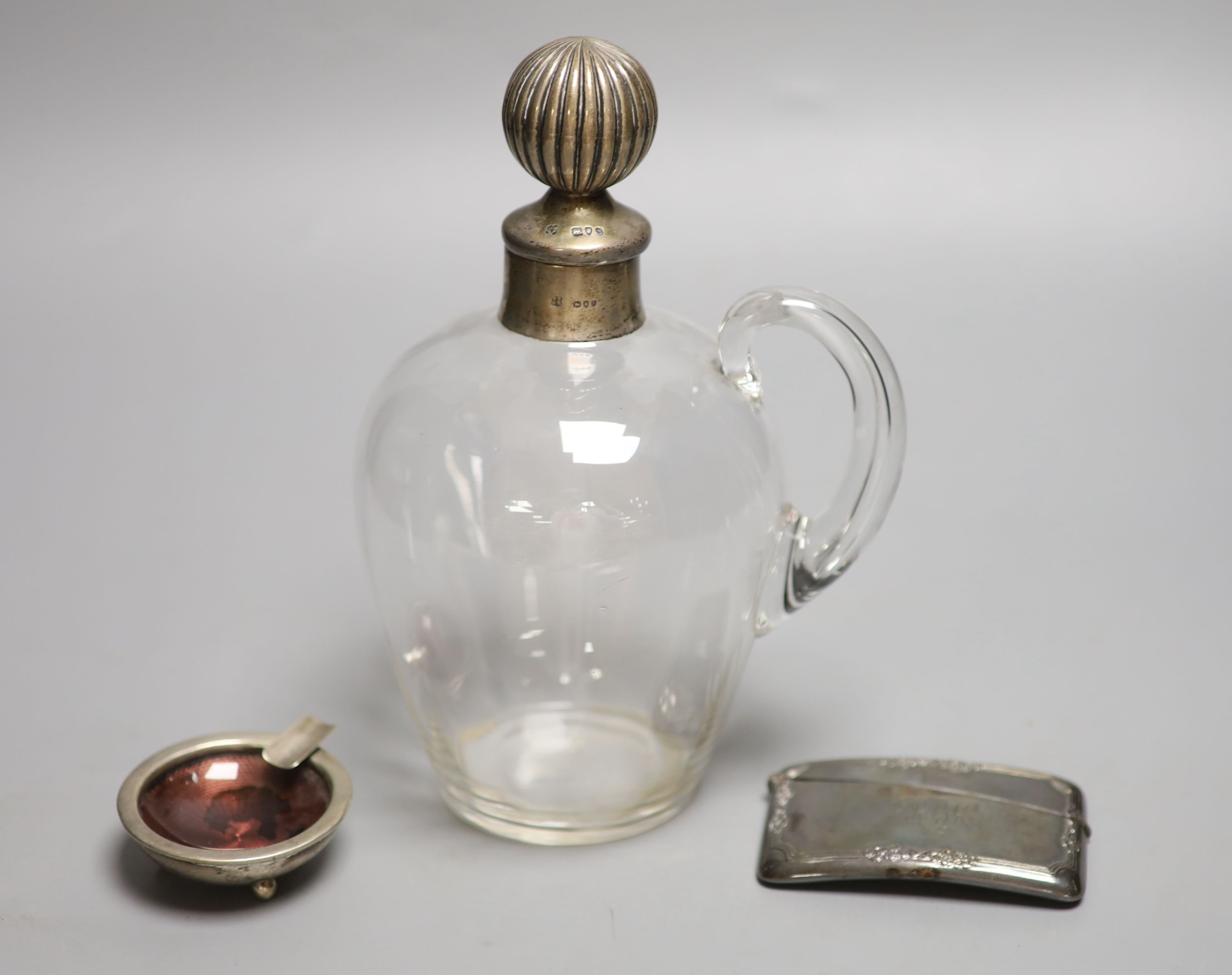 A late Victorian silver mounted glass decanter and stopper, London, 1893, 21.5cm, a silver card case