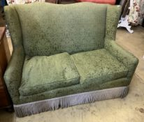 A green damask two seater sofa, width 135cm, depth 70cm, height 100cmCONDITION: Quite comfortable,