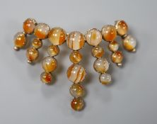 A Victorian yellow metal and cabochon banded agate set crescent shaped brooch, 72mm, gross 18.1
