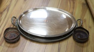 A pair of plated coasters, an oval salver and a trayCONDITION: Both oval trays have scratches and
