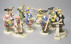 Nine Leslie Ray earthenware monkey bandsmen, height 19cmCONDITION: Seated cellist bow marginally