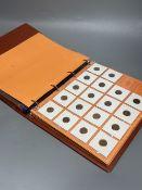 An album of Dutch coins, 1950s-1980s