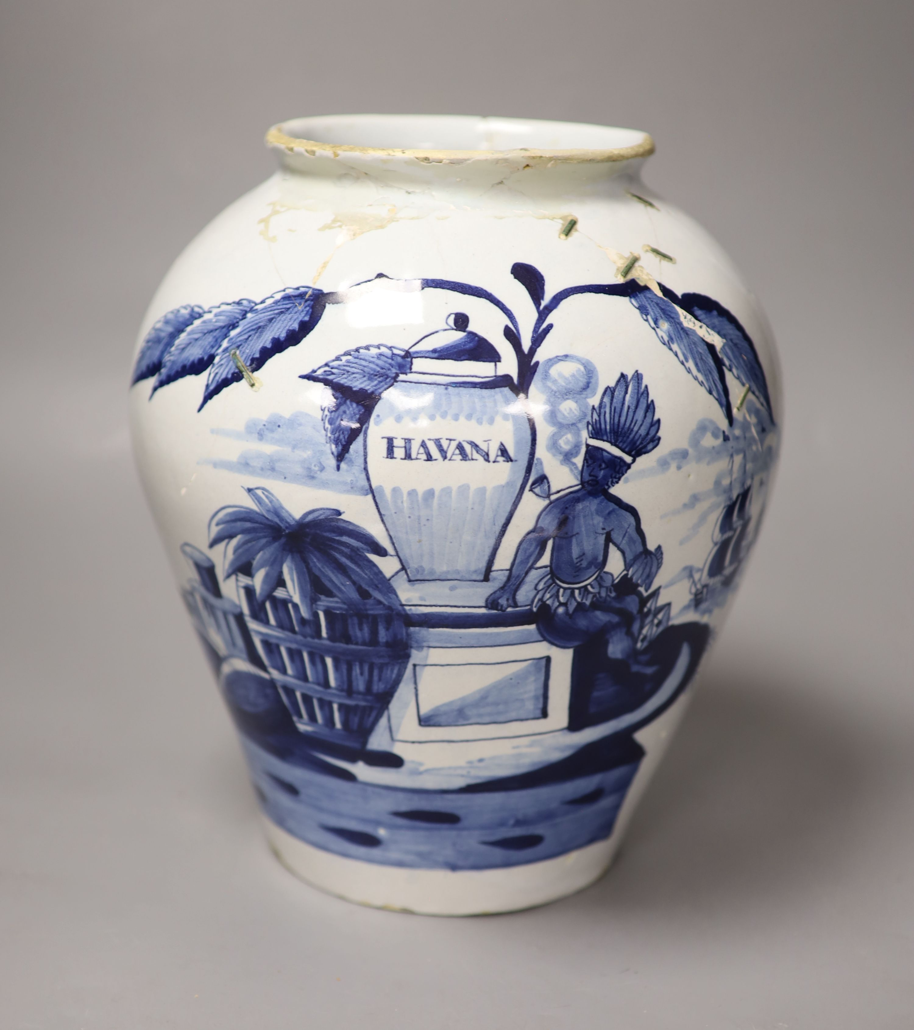 An 18th century Delft 'Havana' tobacco jar, height 26cm (not including cover) (a.f.)