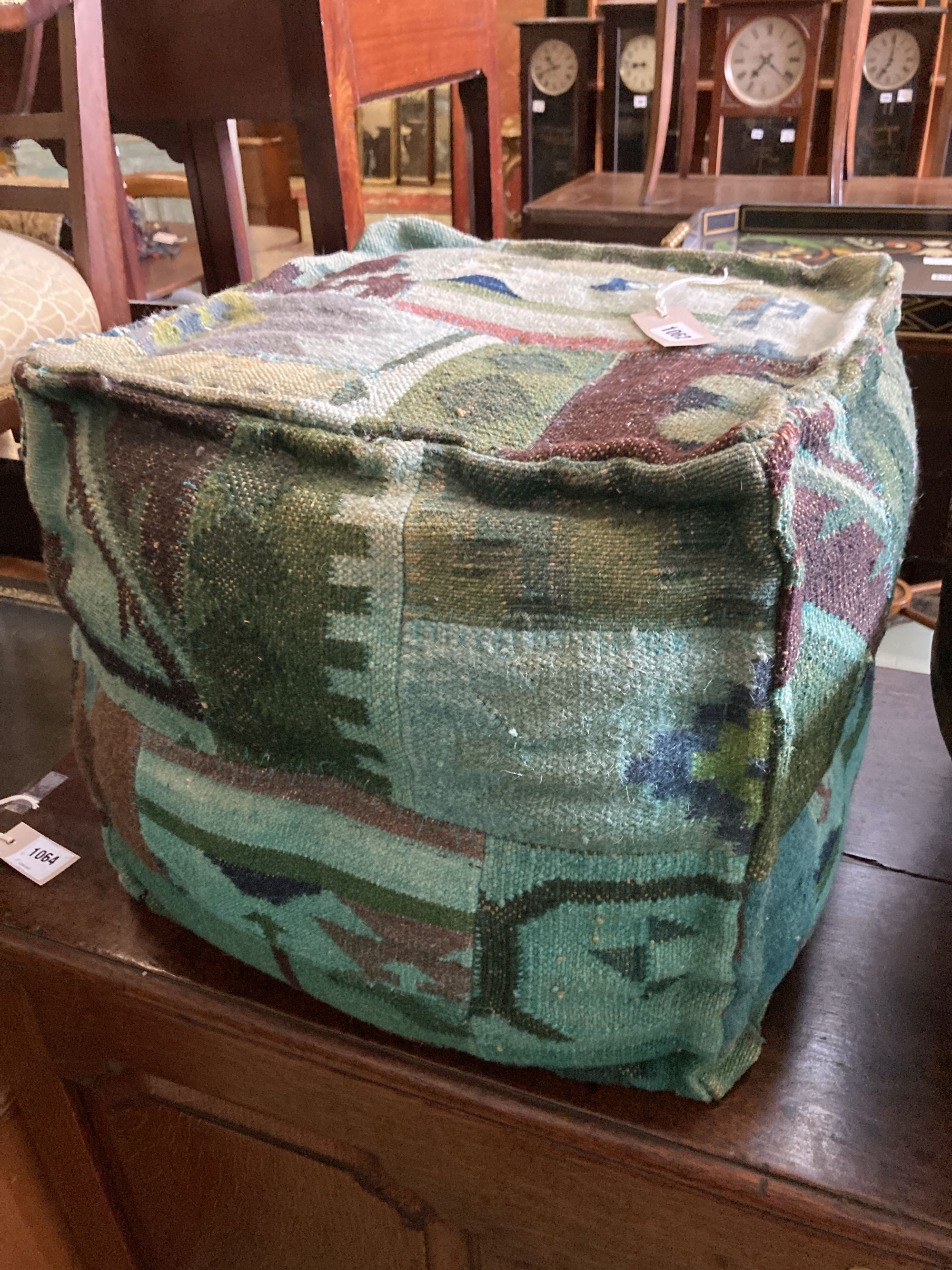 A square Kelim covered footstool, width 42cm, depth 42cm, height 40cm