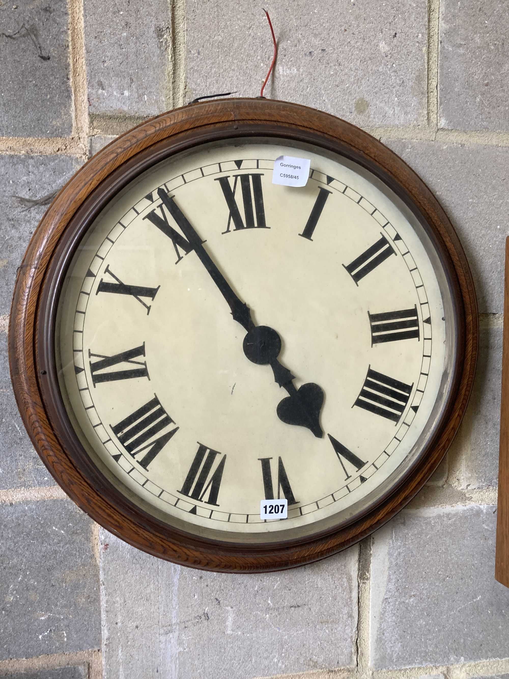 An oak cased electric slave dial timepiece