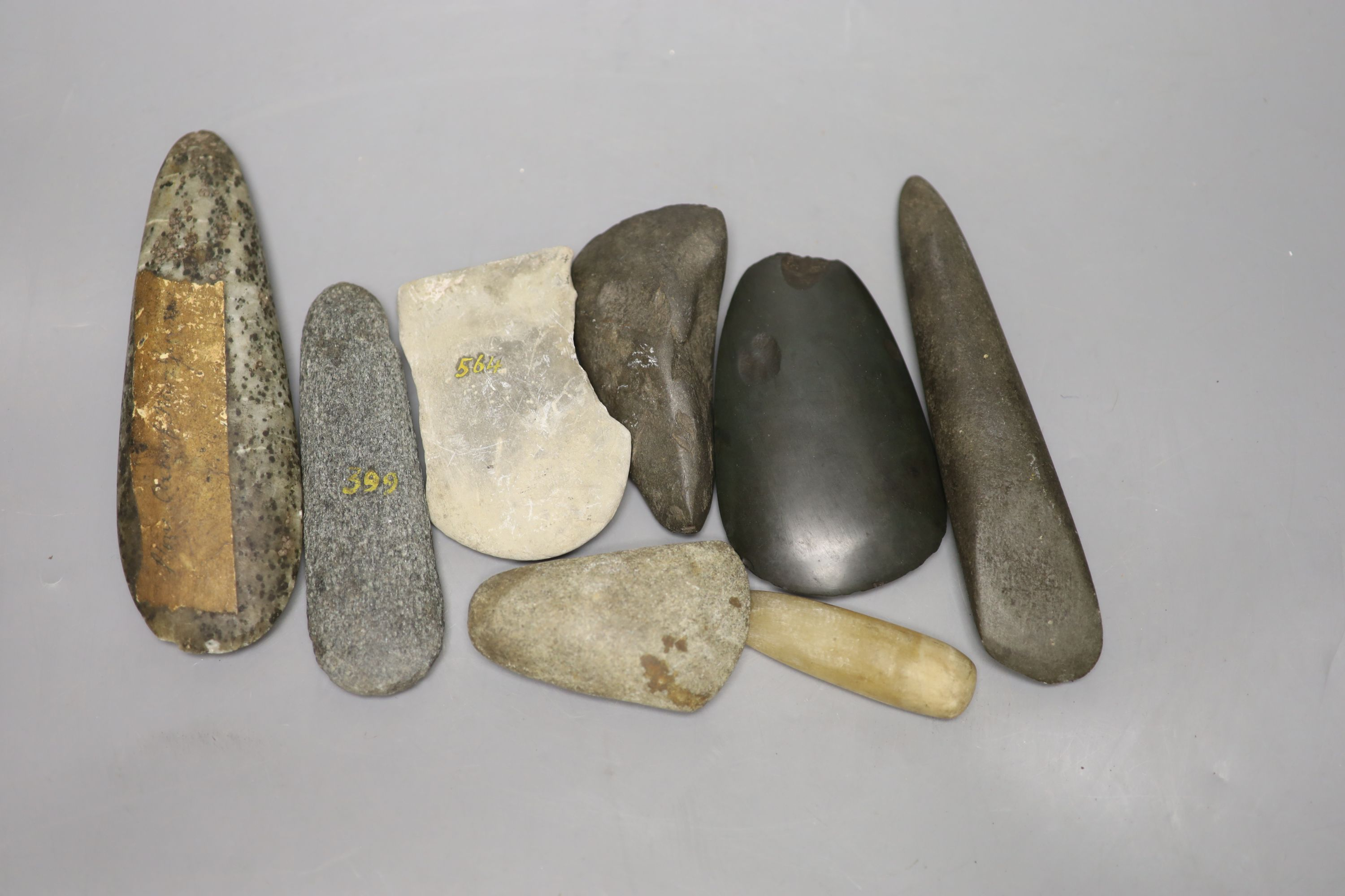 A group of stone adze hand tools, three 19th century Papua New Guinea, each labelled New Guinea,