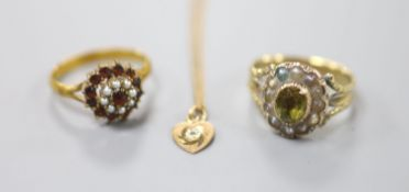 A 19th century yellow metal, foil backed gem and split pearl set dress ring, size O/P (a.f.), one