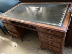 A George III style walnut pedestal desk, fitted nine small drawers, width 154cm, depth 92cm,