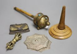 A Tibetan brass prayer wheel, inset with cabochons, with turned wood handle and four other items,