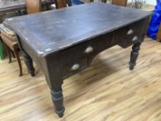 A Victorian stained pine kneehole writing table, width 130cm, depth 90cm, height 76cm