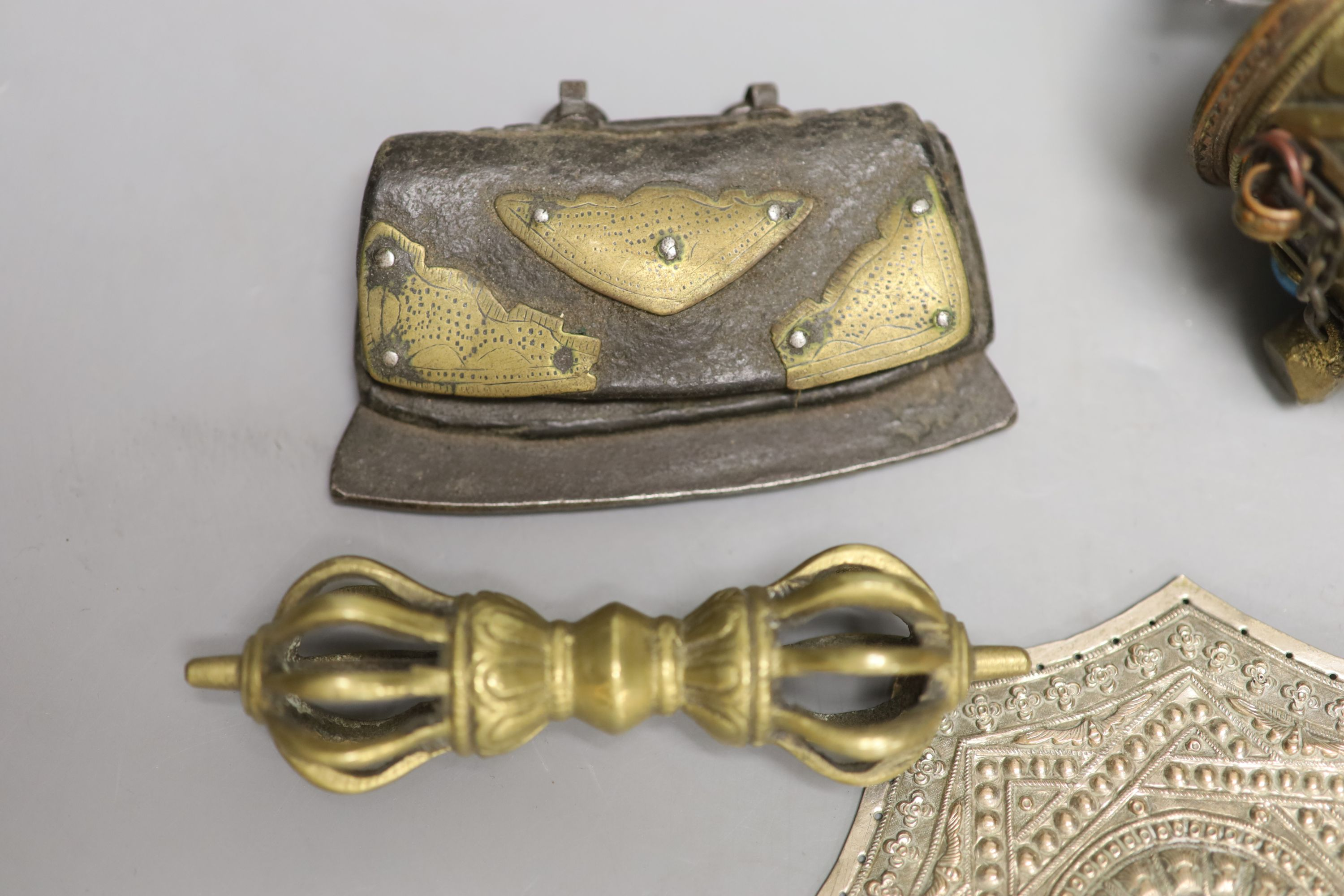A Tibetan brass prayer wheel, inset with cabochons, with turned wood handle and four other items, - Image 4 of 4
