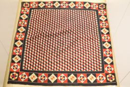 A 19th century 'Crimean' patchwork cover, made from military uniform felt in red, white, black and