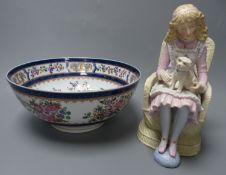 A French coloured biscuit porcelain figure of a seated girl and a Samson 'armorial' bowl, c.1900,