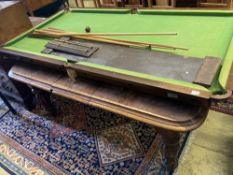 A billiard / dining table, width 183cm, depth 92cm, scoreboard, cues, bridge stick and three balls