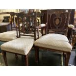 A pair of Edwardian inlaid mahogany elbow chairs and a matching single chair (3)
