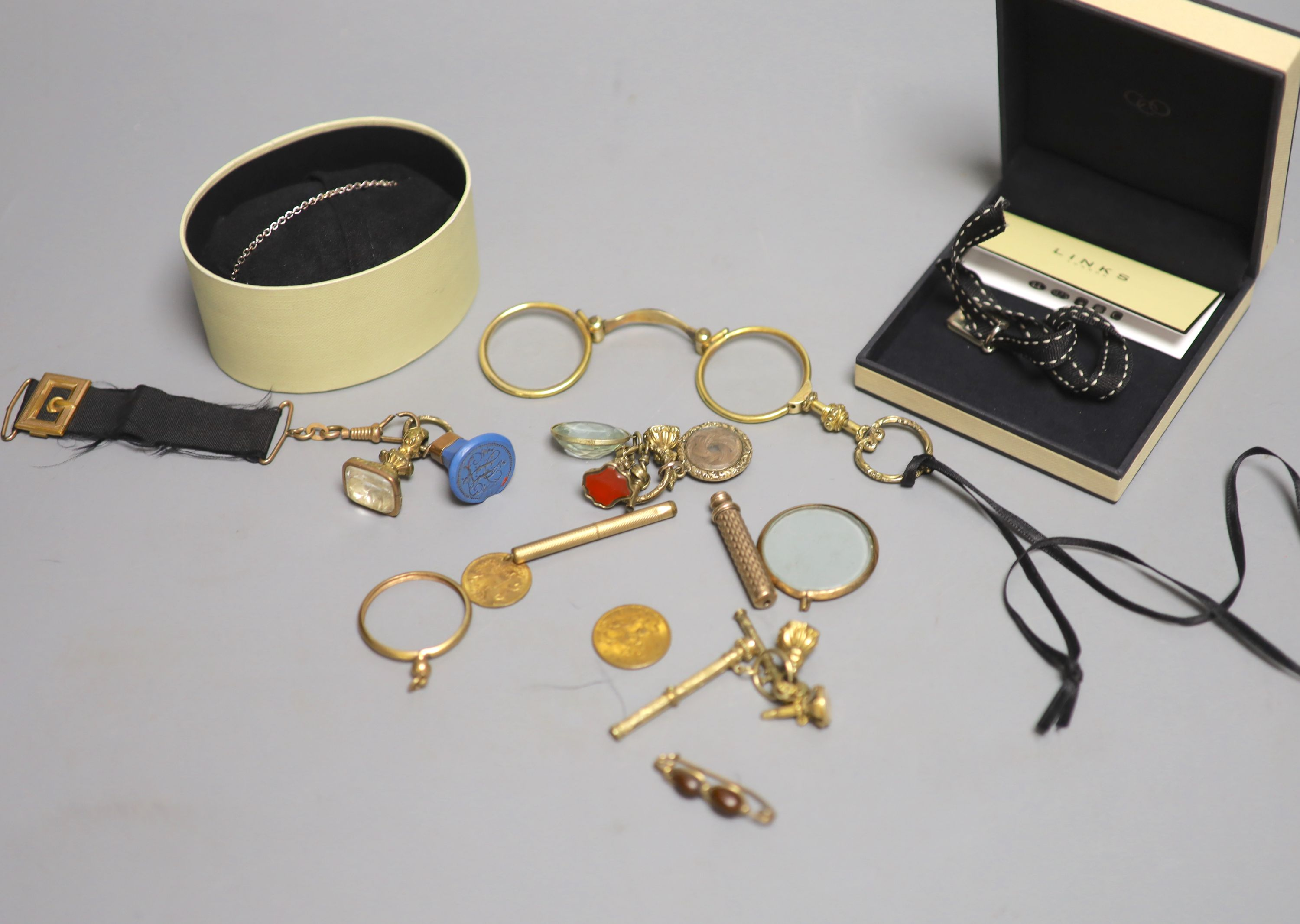 A small group of 19th century and later jewellery, including yellow metal overlaid and gilt metal