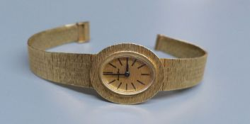 A lady's 9ct gold Bueche Girod manual wind wrist watch, on a textured 9ct gold bracelet, 15.7cm,