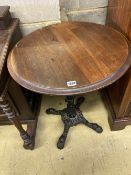 A Victorian style cast iron circular mahogany topped table, 58cm diameter, height 72cm