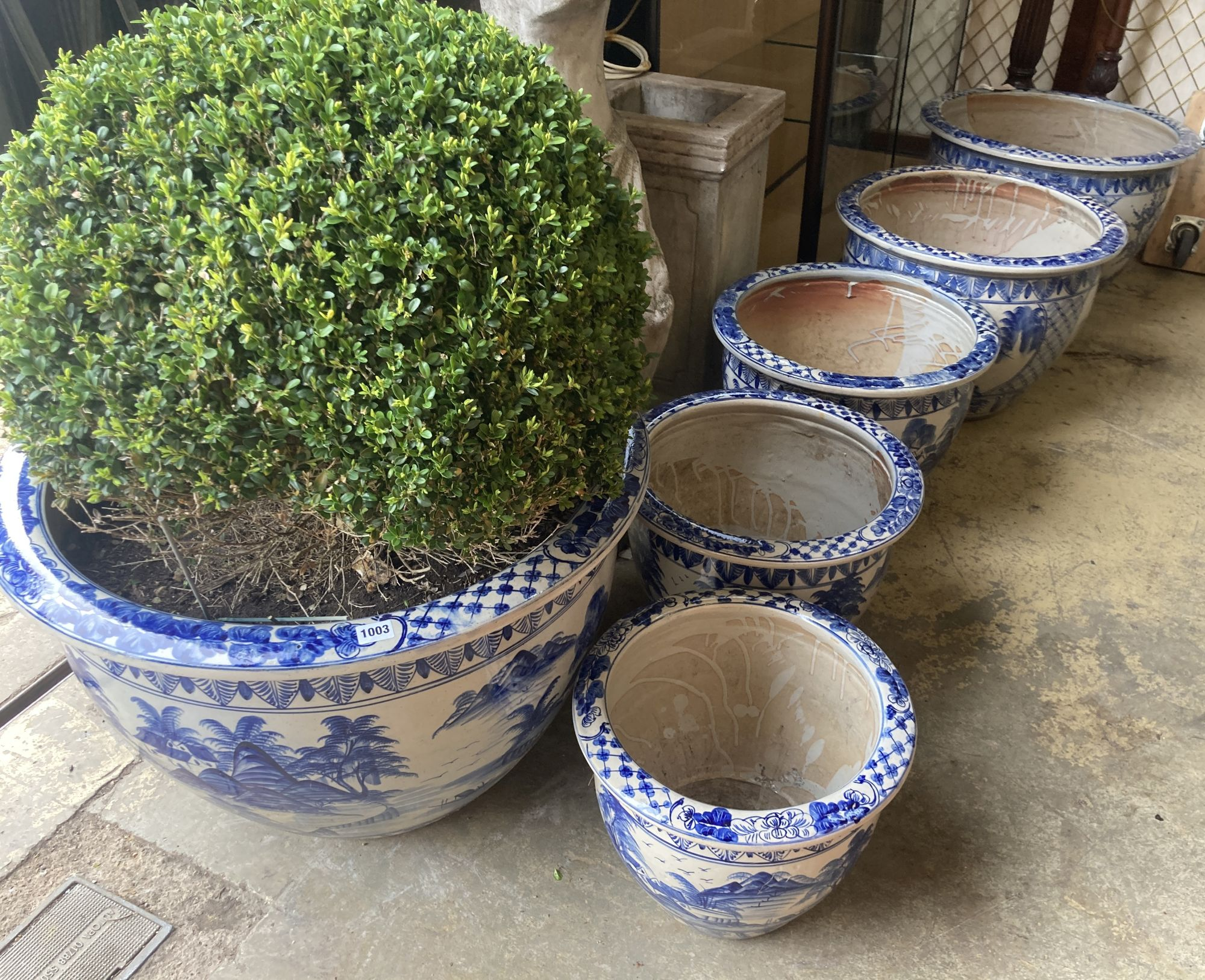 A graduated set of six Chinese style blue and white circular planters, largest width 70cm, height