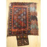 A Turkoman saddle rug, 104 x 82cm and a small carpet bag
