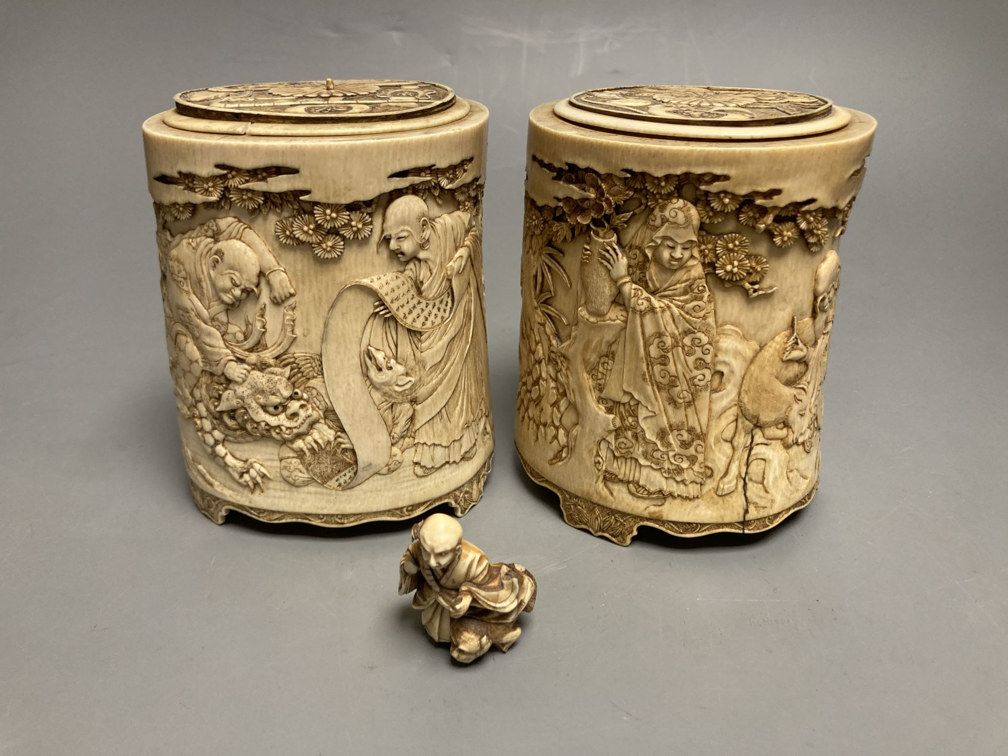 A pair of 19th century Chinese finely carved ivory lidded pots, 12.5cm high and Japanese
