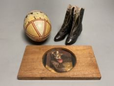 An early 20th century leather decorated easter egg, a pair of 19th century miniature ladies boots