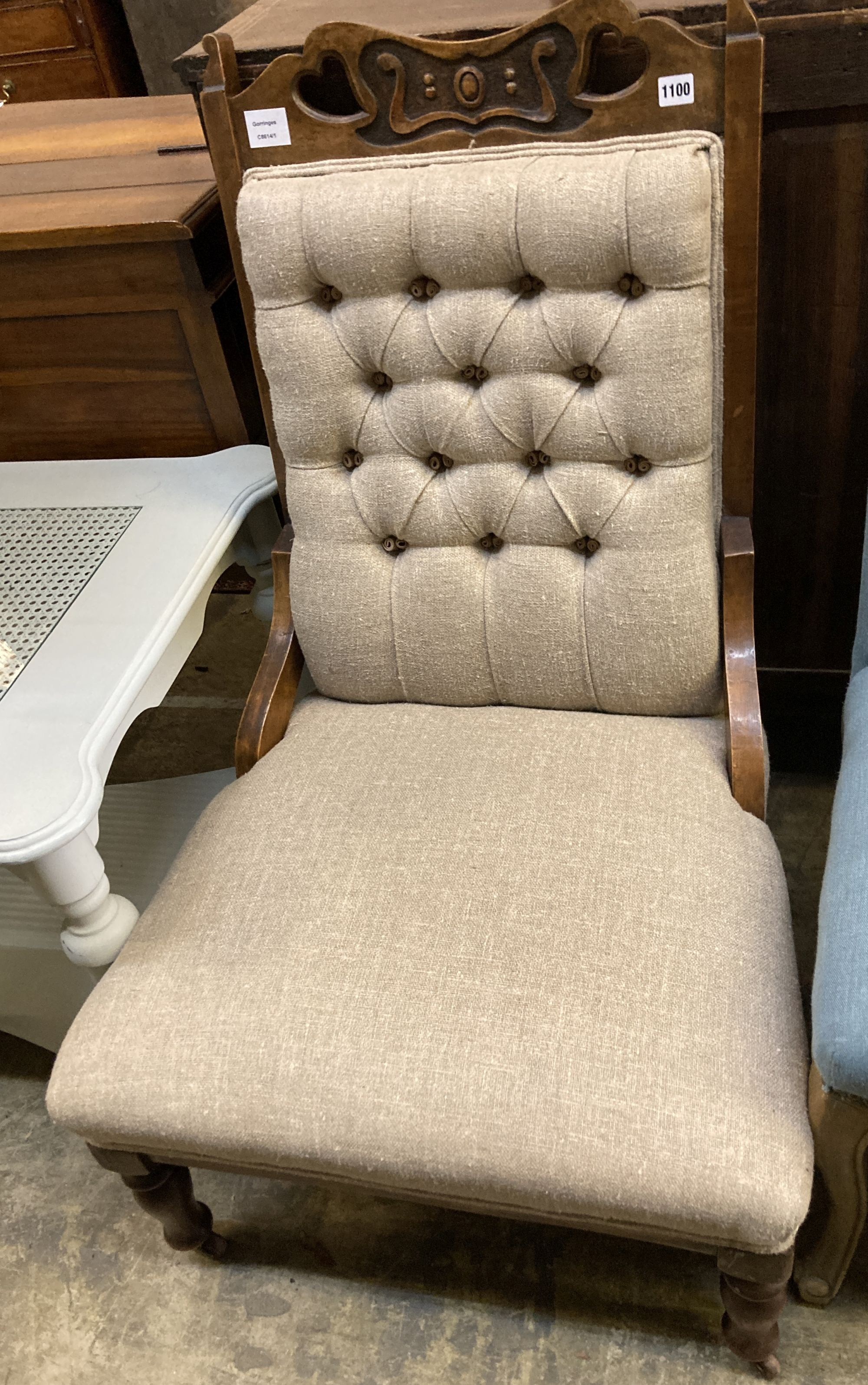 A late Victorian Art Nouveau salon chair, upholstered in buttoned natural fabric, width 60cm,