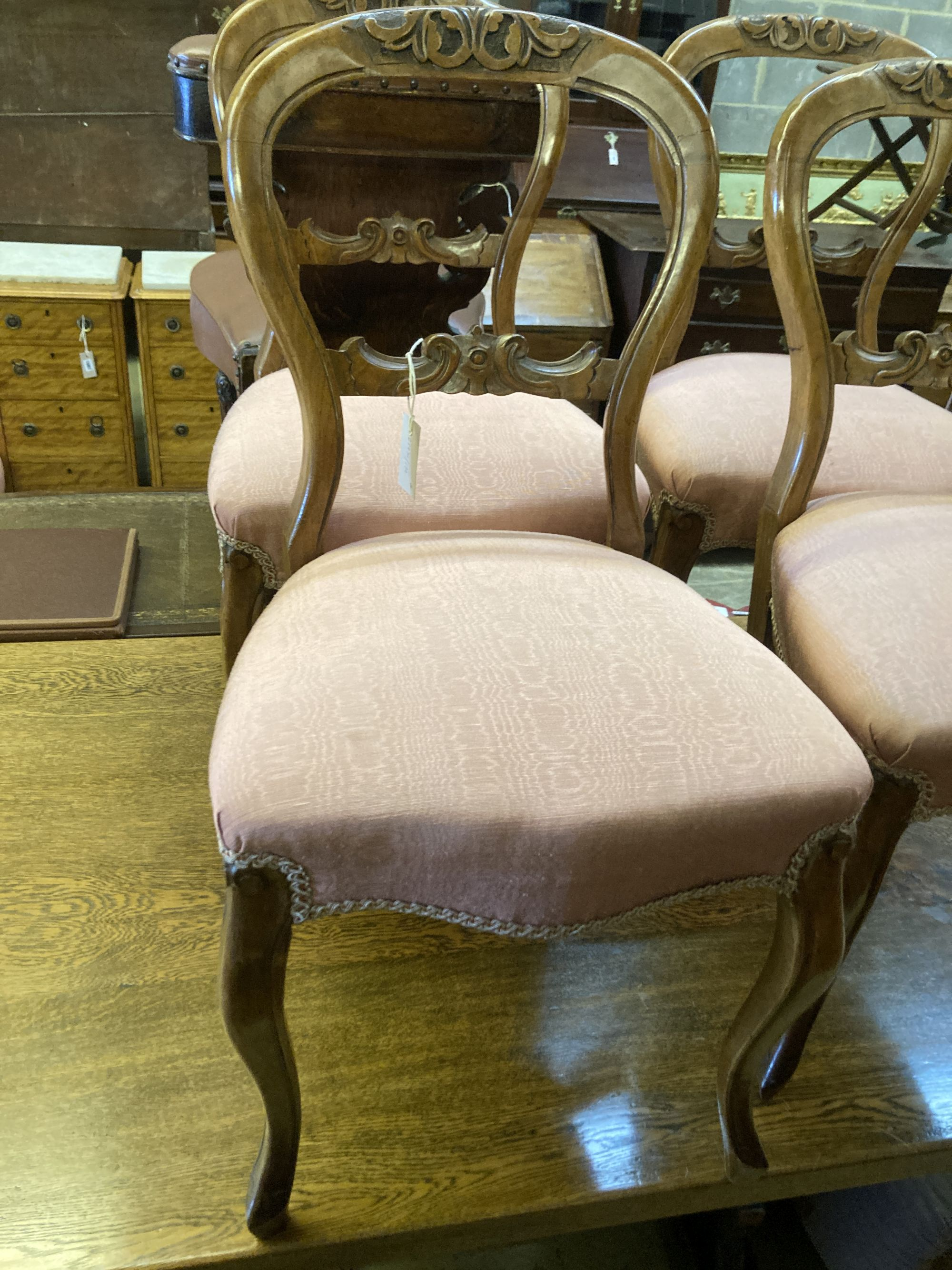 A set of four Victorian walnut balloon back dining chairs - Image 2 of 4