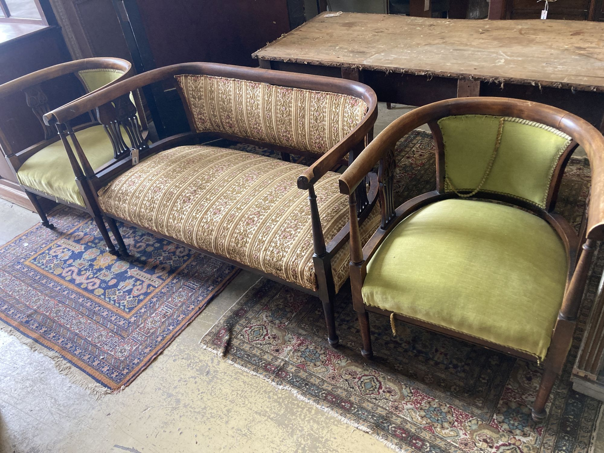 A late Victorian stained beech three piece tub framed salon suite