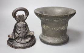 A 16th/17th century bronze mortar, height 16cm, and a cast iron doorstop