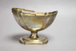 A George III silver gilt swing-handled sugar basket by Henry Chawner, of boat-shaped half-fluted