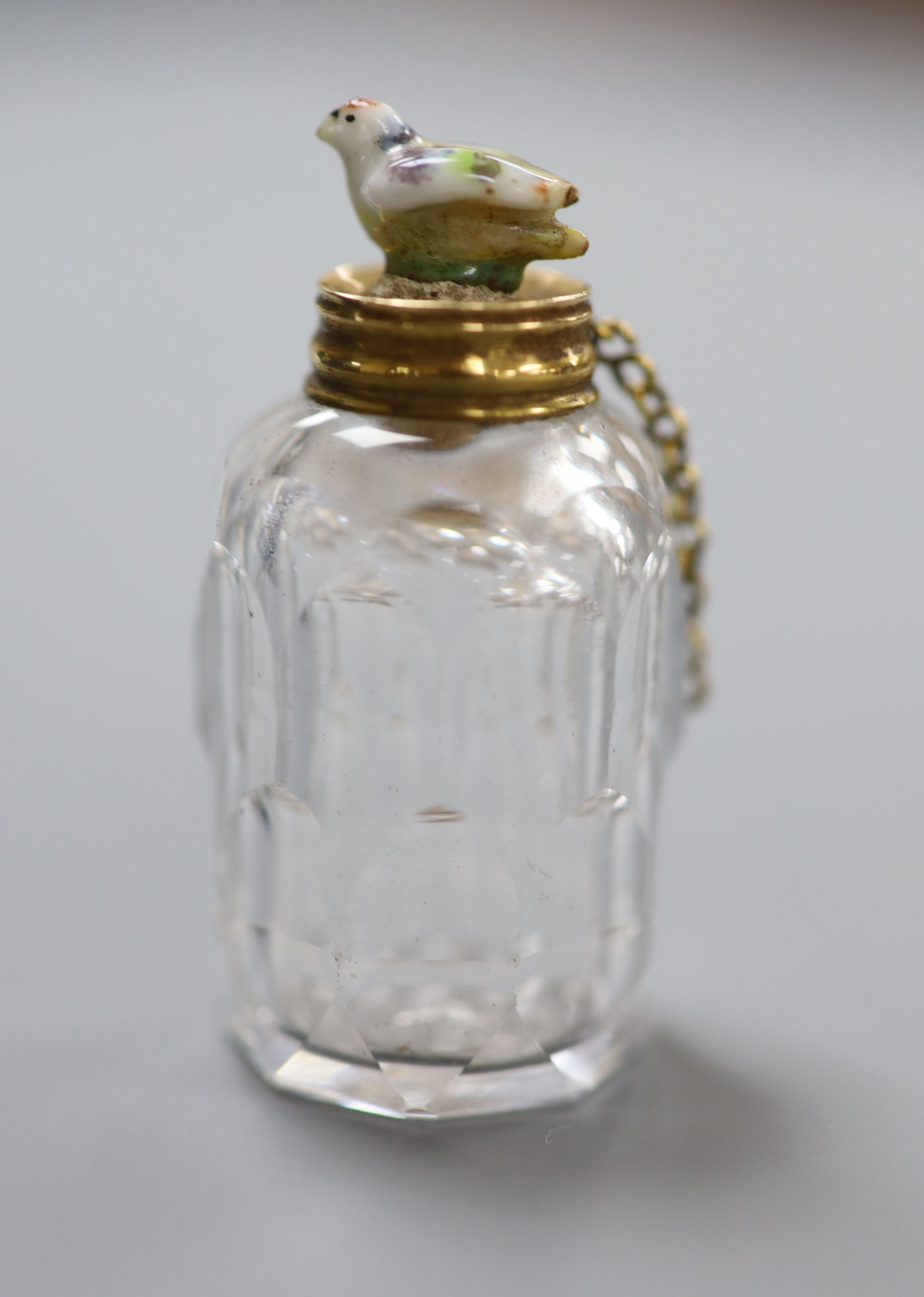 A 19th century yellow metal mounted cut glass scent bottle, with porcelain chick mounted stopper, - Image 2 of 2