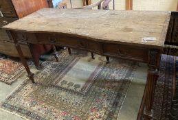 A French walnut dressing table, width 143cm depth 59cm height 79cm (a.f.)