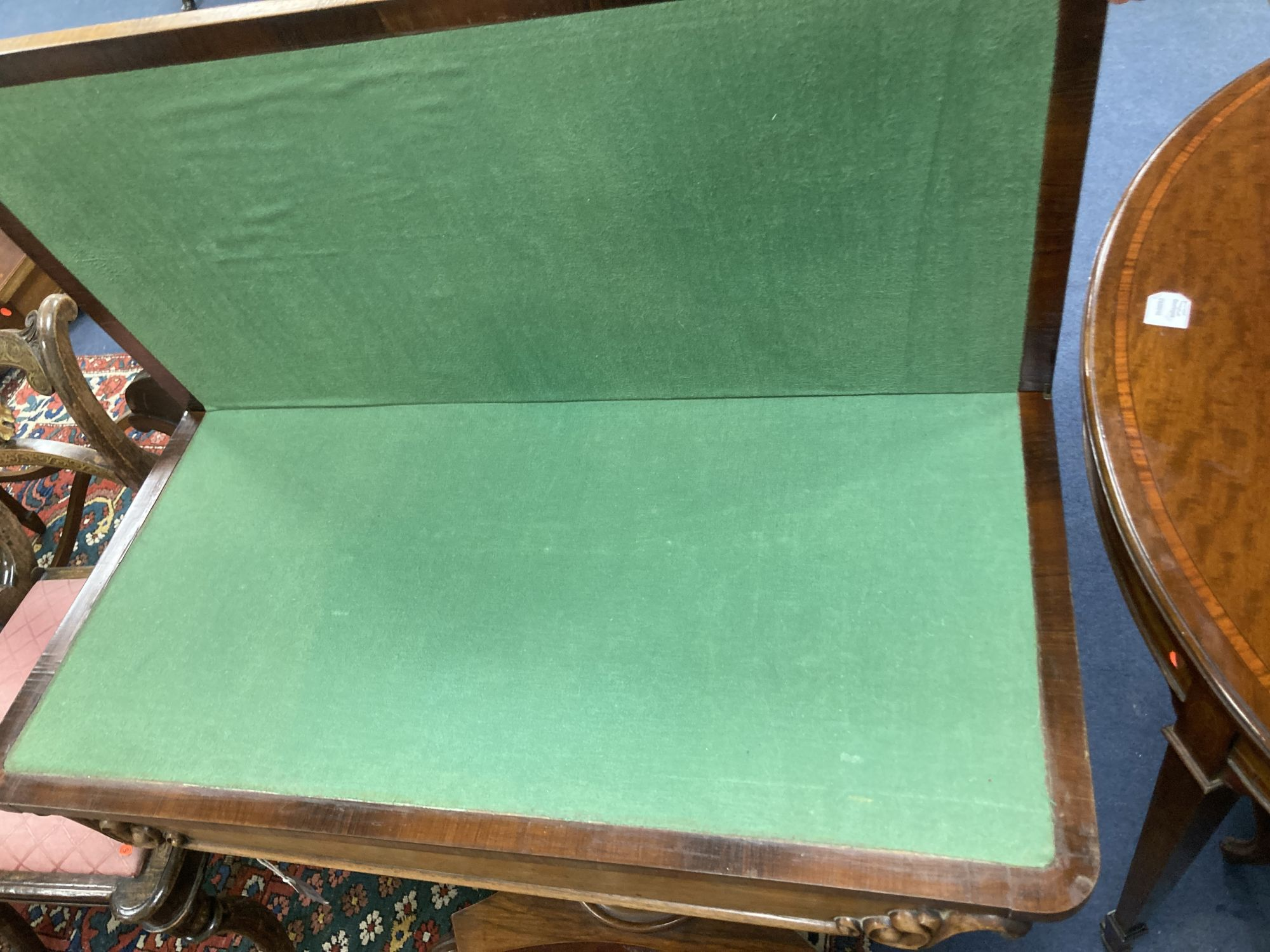 A William IV faded rosewood folding card table, with D shaped folding top, on turned and carved stem - Image 6 of 6