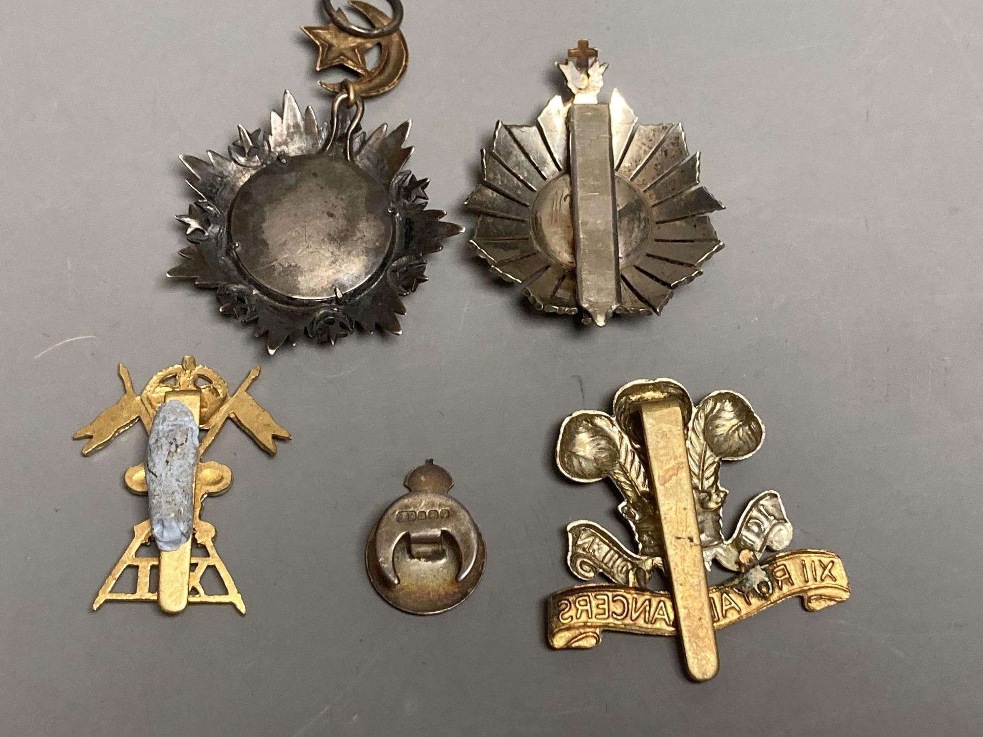 A Turkish Ottoman Order Medjidie Knights Star, another star and three English regimental badges - Image 2 of 2
