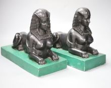 A pair of Egyptianesque composition bookends, each modelled as a Sphinx, width 28cm height 23cm