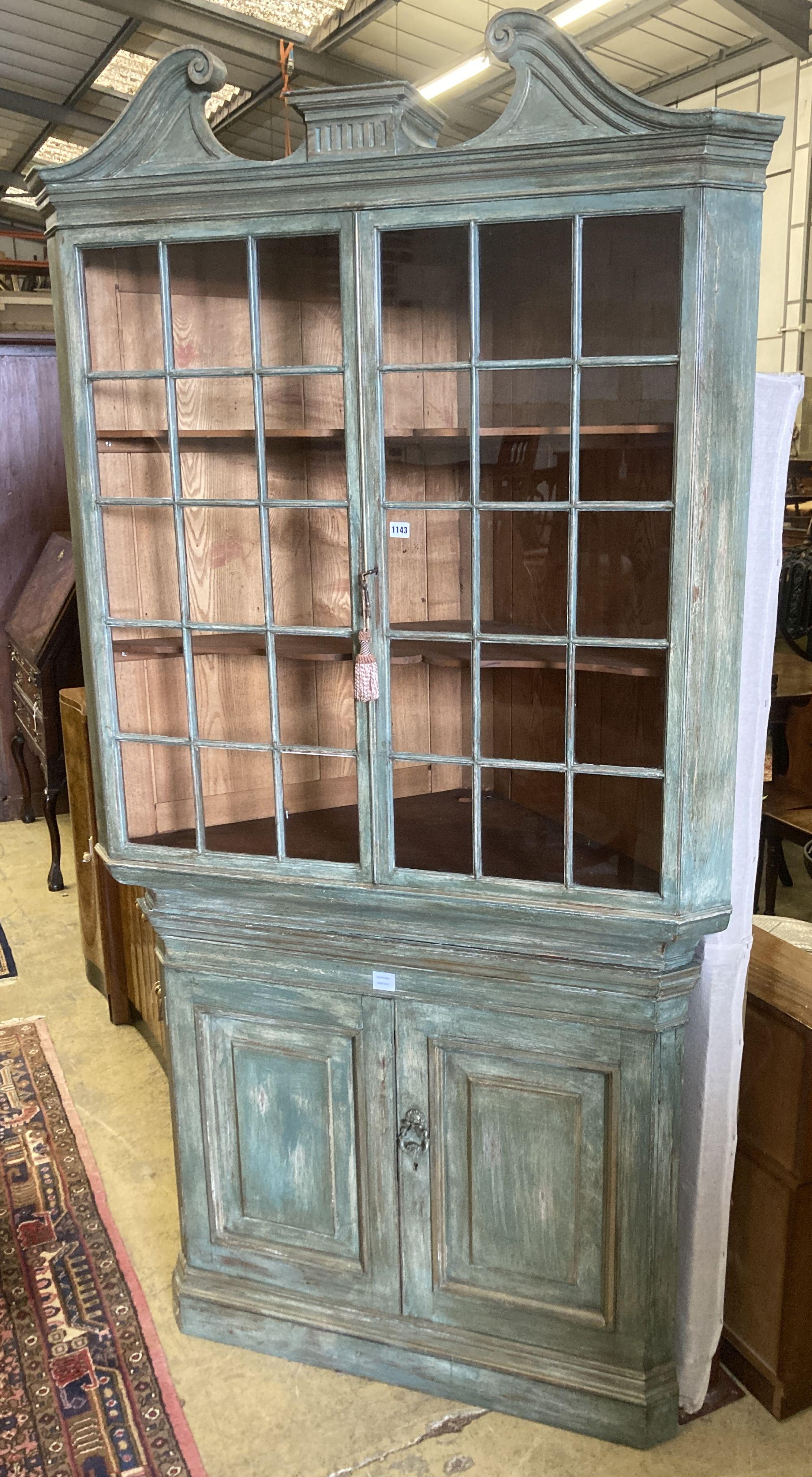 An 18th century style Dutch painted standing corner cabinet, width 112cm depth 60cm height 225cm