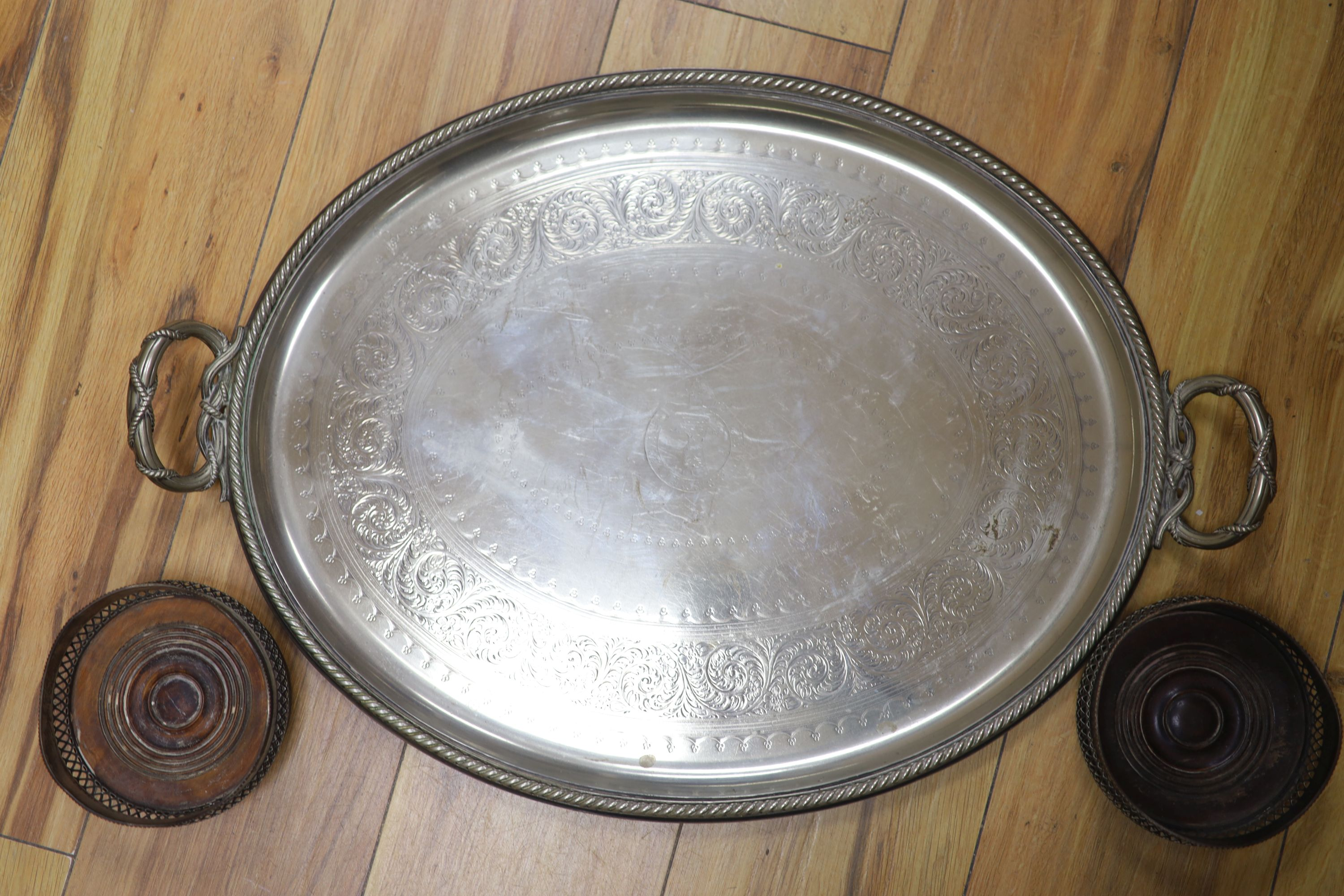 A pair of plated coasters, an oval salver and a trayCONDITION: Both oval trays have scratches and - Image 3 of 3
