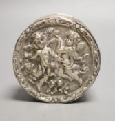 A late 19th/early 20th century German embossed 800 white metal circular box, with hinged cover, 9.