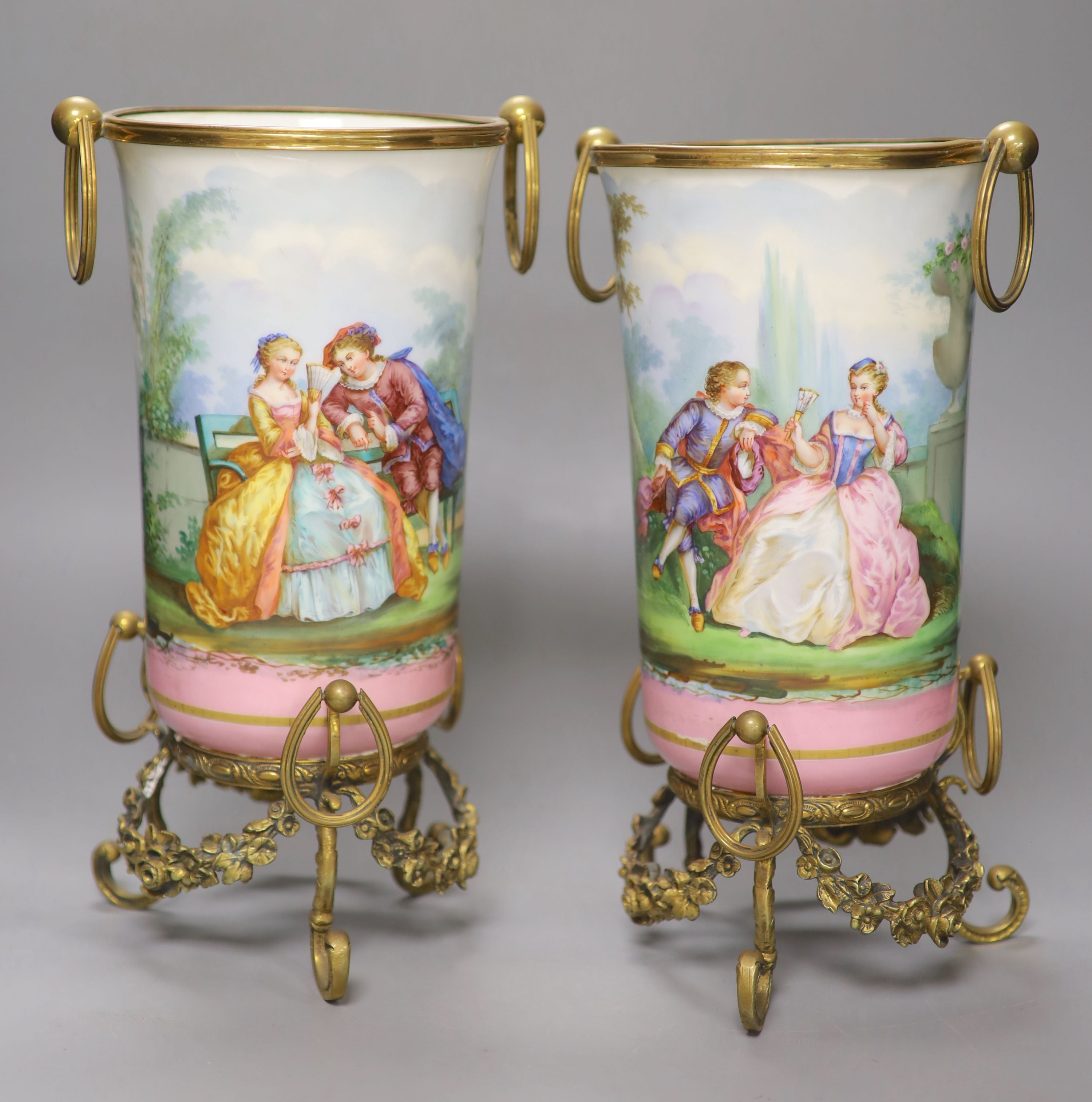 A pair of late 19th century Paris porcelain and gilt metal mounted vases, height 33cmCONDITION: Good