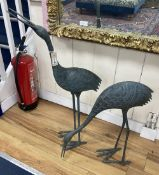 A pair of patinated bronze cranes, larger 89cm high