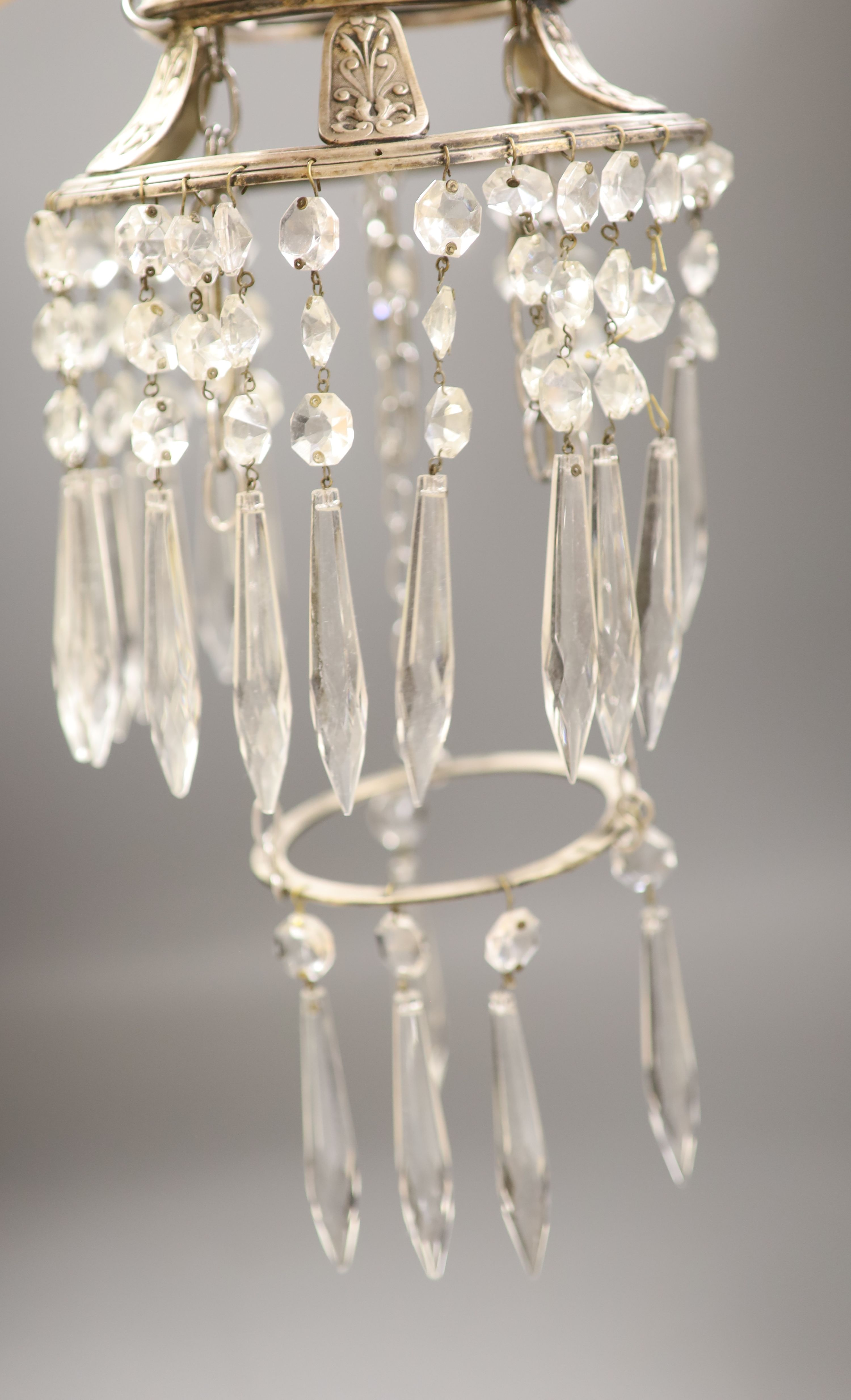 A plated ceiling light hung with clear glass drops